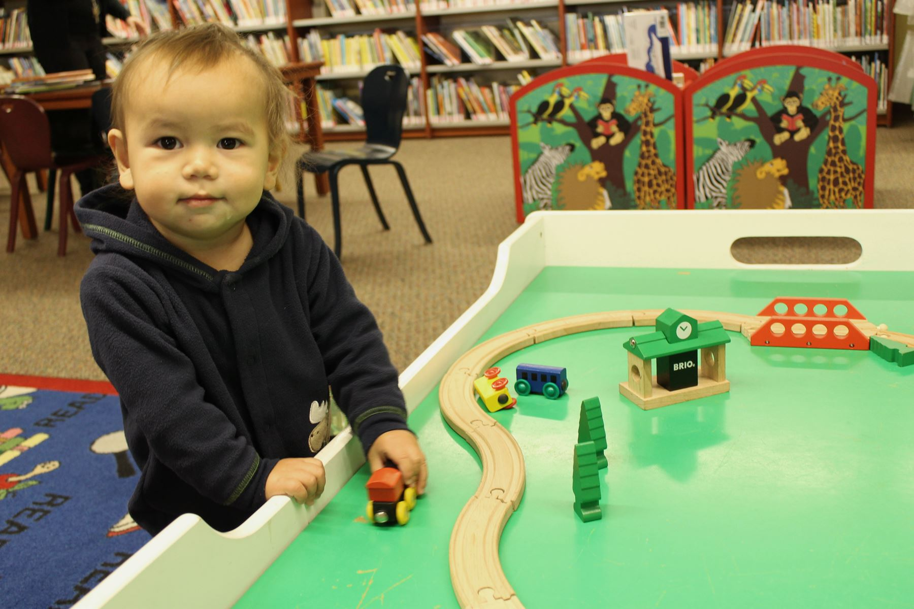 Boy playing with toys in the library
